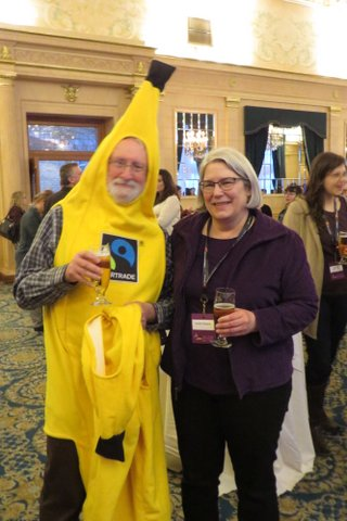"""""""Zack goes bananas for Fair Trade"""" Zack Gross is a long time board member and MCIC employee; and Jennifer Thompson, long-time Marquis supporter"""